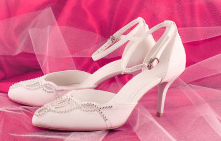 Closeup of fashionable bridal wedding shoes photo