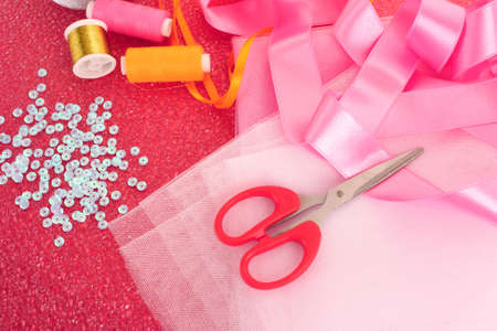 needle, threads, scissors, ribbons  and measuring tape Stock Photo - 8167389