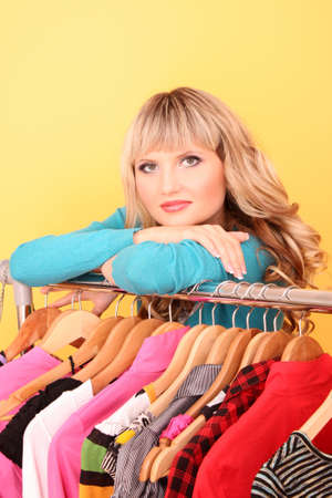 Happy young woman shopping for clothes at the shop Stock Photo - 8167416