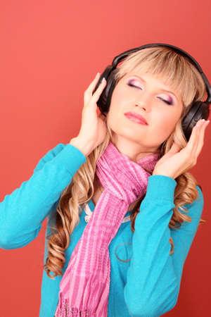 Beautiful young  women listening music in headphones photo