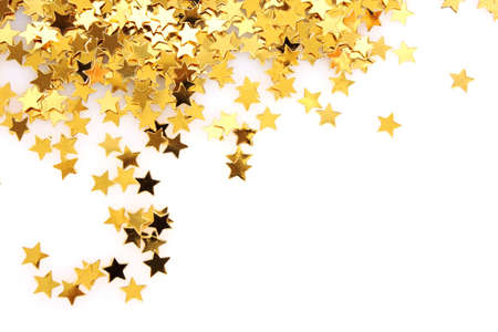 Golden stars in the form of confetti on white photo