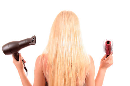 Portrait of  woman,  holding hair dryer photo