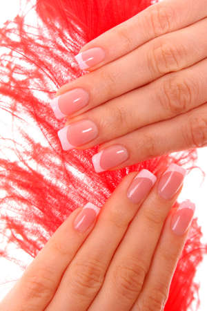 manicured hands: Beautiful woman hands with french manicure on yellow background
