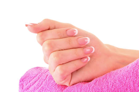 Beautiful woman hand  with french manicure on pink background Stock Photo - 8253283