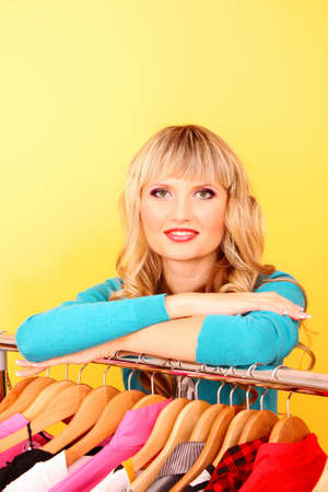 Happy young woman shopping for clothes at the shop Stock Photo - 8253295