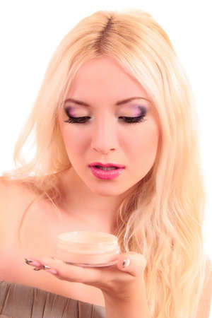 Portrait of attractive young blonde woman applying blusher Stock Photo - 8253555