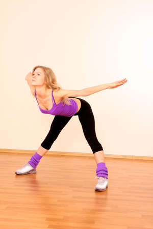 Young beautiful fitness girl exercising  in the gym Stock Photo - 8253543