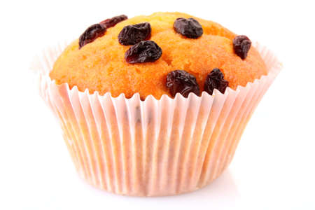 Muffin with raisins isolated on white photo
