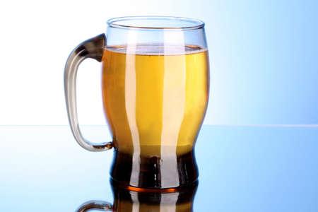 Mug of beer on blue background Stock Photo - 8331492