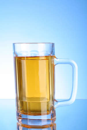 Mug of beer on blue background Stock Photo - 8331511