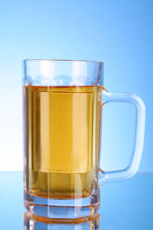 Mug of beer on blue background Stock Photo - 8331515