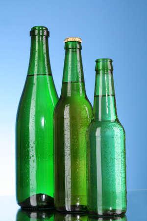 Bottles of beer on blue background photo