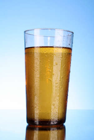 Cup of beer on blue background Stock Photo - 8331508