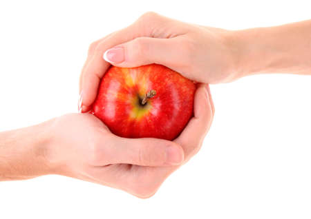 Apple between man and woman hand on white background photo