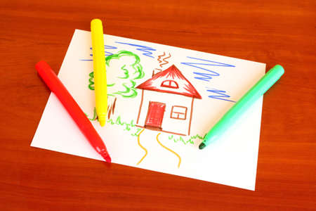 child's drawing: Childs drawing and pens on the table