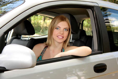young woman in her new car photo