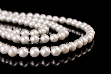 White pearls on  black  background Stock Photo - 8413741
