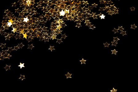 Decoration of golden stars isolated on black Stock Photo - 8457637