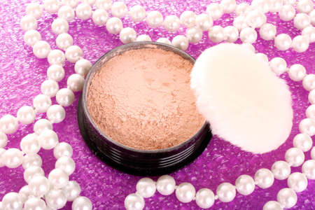 makeup powder on pink background photo