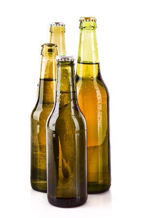 Many bottles of beer isolated on white Stock Photo - 8514339