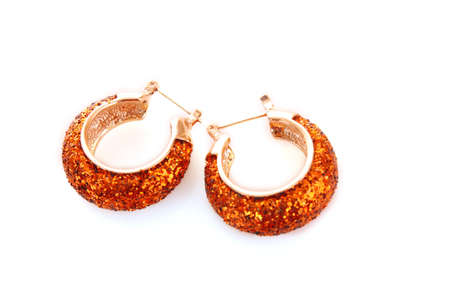accessorize: Golden earring on white background