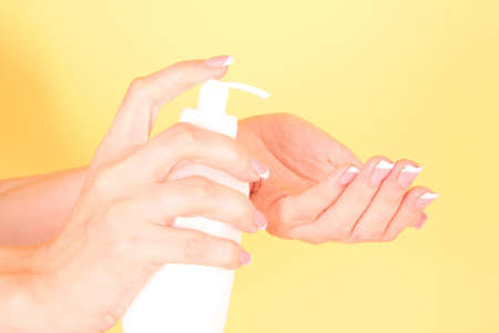 Woman applying cream on her hand Stock Photo - 8665114