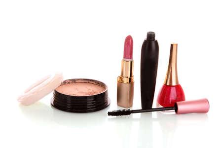 Face powder, mascara, lipstick and nail polish on white background photo