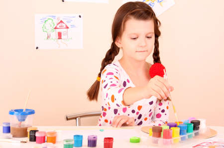 young and cute little girl painting a picture Stock Photo - 8721084