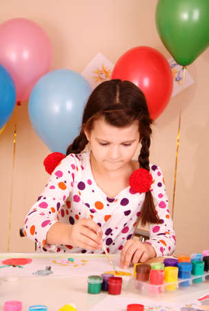 young and cute little girl painting a picture photo