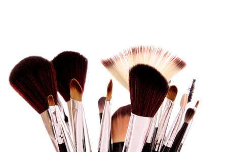 grooming product: cosmetic brushes on white