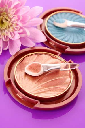 eyeshadows on violet background photo