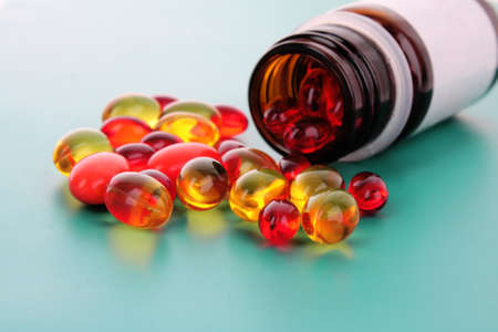 red capsules of vitamins on a blue background Stock Photo - 8721066