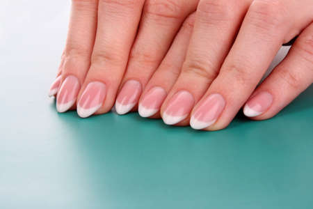 nails with a French manicure on a blue background photo