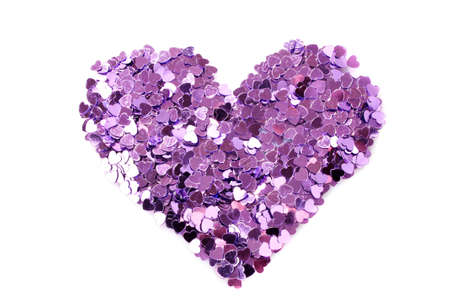 Violet hearts  in the form of confetti on white Stock Photo - 8721441