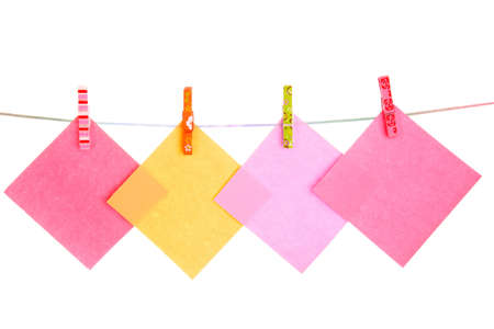 Blank paper sheets on a clothes line on a white background Stock Photo - 8721709