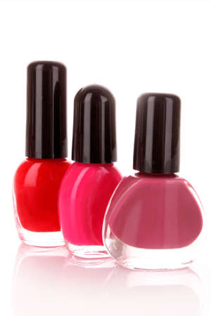 Nail polish bottles in  d on a white background photo