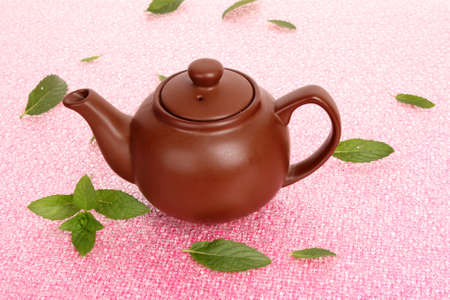 Teapot with  green tea  with mint photo