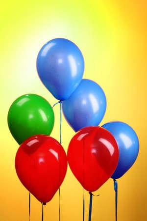 Flying balloons on yellow background Stock Photo - 8721815