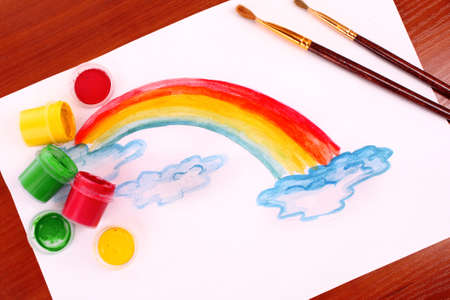 Children drawing of a rainbow on a paper photo
