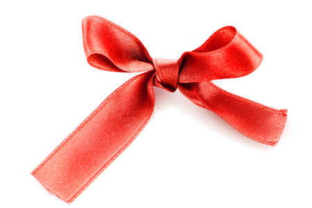 Red satin gift bow isolated on white photo