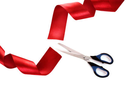 Red ribbon with scissors isolated on white Stock Photo - 8721784