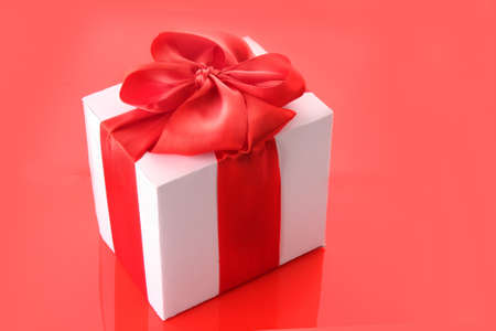 gift box close up  on red background photo