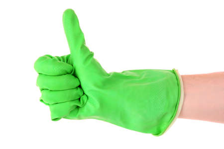 Thumbs up with a green  glove on white photo