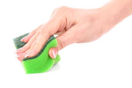 Hand and kitchen sponge photo