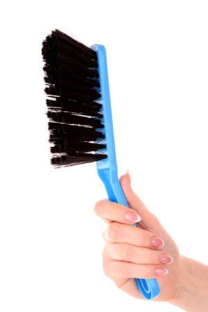 hand with  brush on white photo