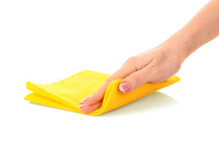 Hand with clean rag on white background photo