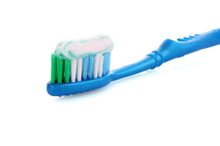 Tooth Paste on the blue  Brush isolated with white background photo