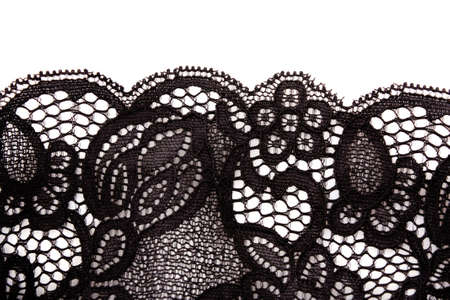 over black: Lace closeup isolated on white Stock Photo