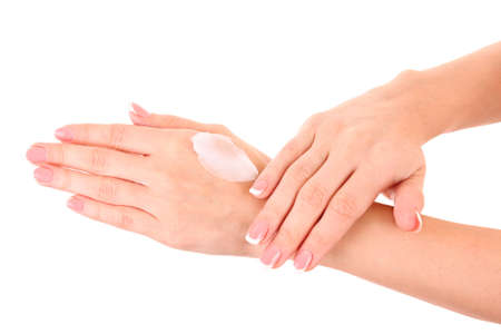 Closeup of beautiful female hands applying hand cream isolated on white background photo