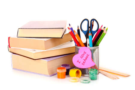 Felt pens with a memo note saying I love school and books on white background photo
